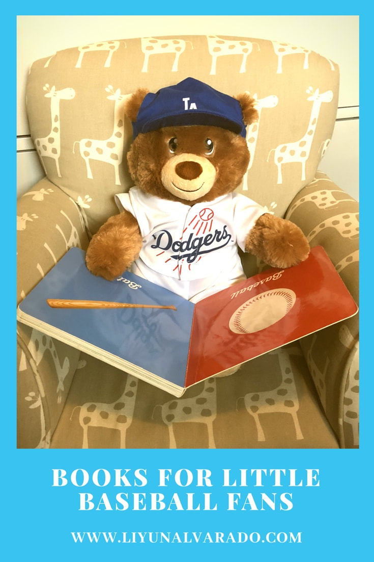 Teddy Bear in a Dodgers uniform reads a baseball board book.